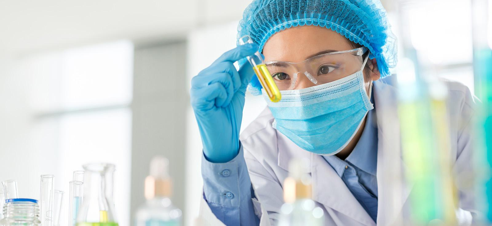 Woman in Lab with Fine Chemicals